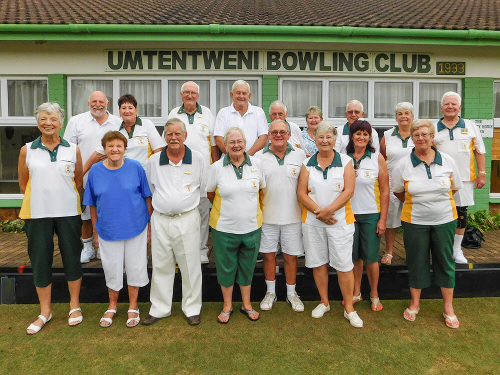 Bowling club members standing in a group in front of the club house